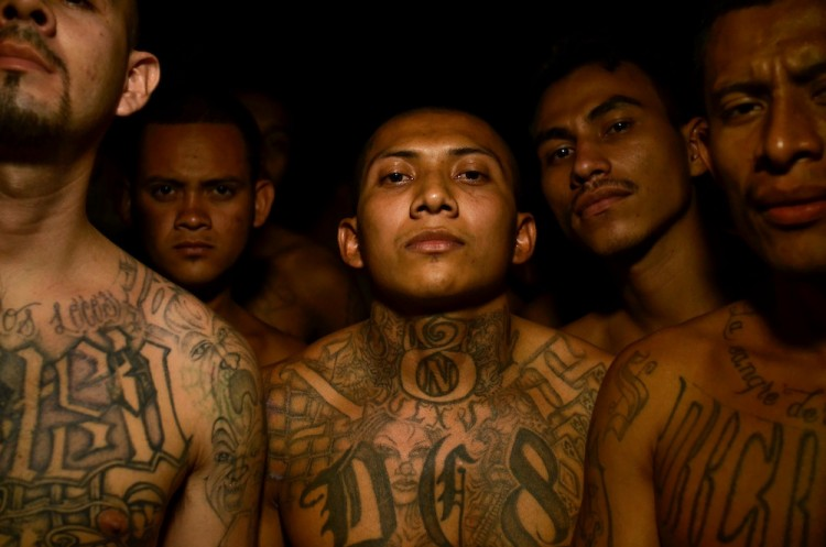 Members of the MS-18 gang incarcerated in Izalco mens' prison in El Salvador pose for a portrait inside their overcrowded cell.